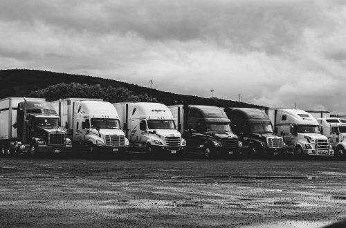 parked-trucks-under-clouds-2348359